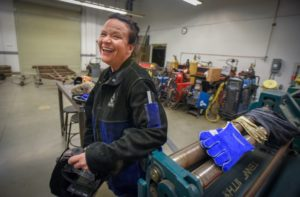 Person smiling in welding shop